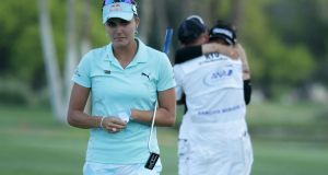 Lexi Thompson walking off the 18th green after So Yeon Ryu of the Republic of Korea  defeated her  in a playoff during  the ANA Inspiration  at Mission Hills Country Club in California on April 2nd, 2017. Photograph:  Jeff Gross/Getty Images