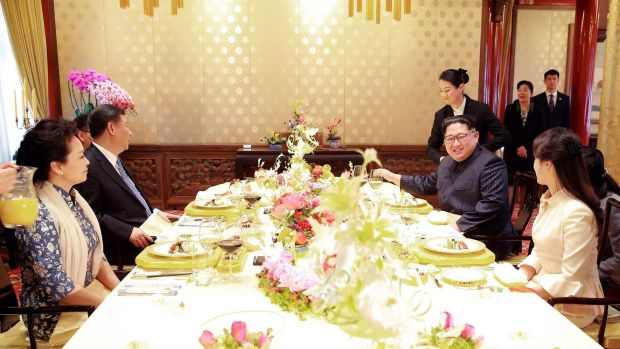 Chinese president Xi Jinping and his wife sit down for lunch with North Korean leader Kim Jong-un and his wife in Beijing. Photograph: AFP/Getty Images