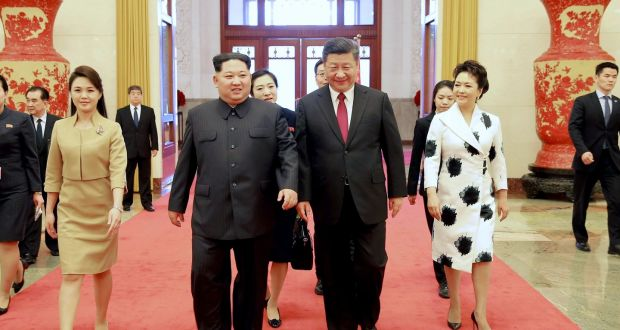North Korean leader Kim Jong-un and his wife are accompanied by his Chinese counterpart Xi Jinping and his wife at the Great Hall of the People in Beijing. Photograph: Korea News Service via AP
