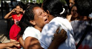 Relatives of inmates held at the General Command of the Carabobo Police react as they wait outside the prison, where a fire occurred in the cells area in Valencia. Photograph: Carlos Garcia Rawlins/Reuters