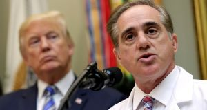Donald Trump listens as then secretary of Veterans Affairs David Shulkin speaks during an event at the White House in Washington last year. Photograph: Joshua Roberts/Reuters