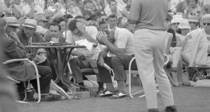 Argentine golfer Roberto De Vicenzo holds his head after he signed incorrect scorecard and cost himself a tie for the Masters Golf Tourney here on April 14th. De Vicenzo actually finished in a tie with Bob Goalby, but the mistaken scorecard cost him a stroke and Goalby won.