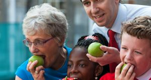 The Ministers for Health and Children respectively, Simon Harris, TD, and Katherine Zappone, TD, at the launch of 'A Healthy Weight for Ireland - Obesity Policy and Action Plan 2016-2025'. Pictured with the ministers are Bisi Atelade (11), from St Audoen's NS and Charlie McCormack (10) Talbot SNS. Photograph: Dave Meehan