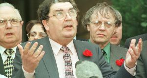 The SDLP leader, Mr John Hume, hails the settlement after yesterday's marathon session ended at Stormont. Photograph: Alan Betson