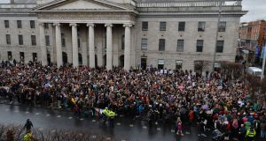 People gather on O'Connell Street on Thursday to support the complainant in the Belfast rape trial. Photograph: Alan Betson/The Irish Times