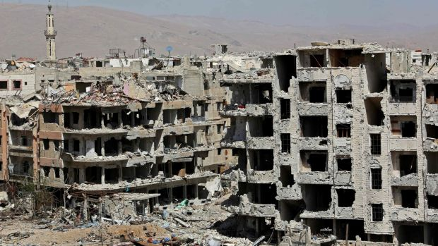 Destroyed buildings in Harasta nearly a week after the regime forces retook the town from the rebels, in eastern Ghouta on the outskirts of Damascus. Photograph: Strstr/AFP/Getty