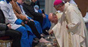 Archbishop Diarmuid Martin performs the Washing of the Feet ceremony  on Thursday, including members of the Palestrina Boys Choir. Photograph: Dave Meehan