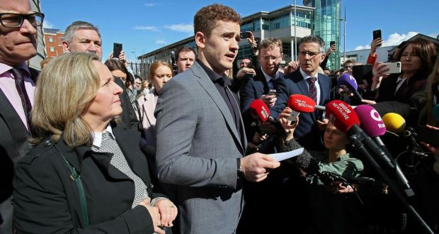 Paddy Jackson speaks to the media as he leaves court in Belfast after being  found not