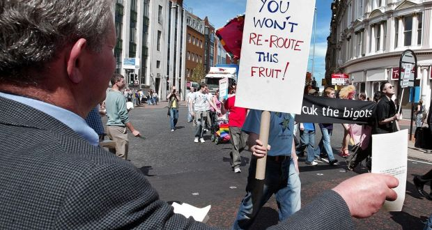 A man hands out religious tracts to people taking part in the Belfast gay pride parade in August, 2004. Photograph: Brendan Murphy