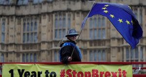 Anti-Brexit demonstrators wave European Union flags from the top deck of a bus parked outside the Houses of Parliament in London on Thursday. Photograph: Daniel Leal-OLivas/AFP/Getty Images