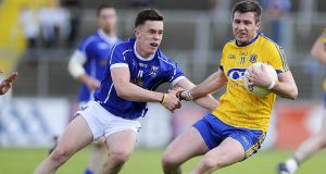 Cavan's Niall Murray with Roscommon's Cathal Cregg during the All-Ireland championship qualifier at Kingspan Breffni Park in 2015. Roscommon won 3-17 to 1-16. Photograph: Tommy Grealy/Inpho