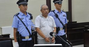 Gao Chengyong attending his trial in Baiyin, Gansu, in July 2017: he slashed the throats of his female victims and dismembered them. Photograph: Stringer