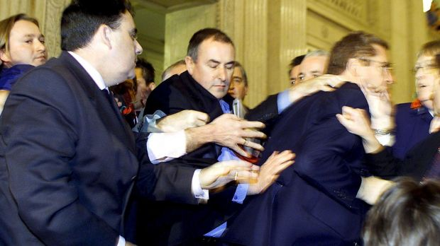 This division between the pacified bourgeois intellect and the hysterical and excessive was exemplified in 2001, when the David Trimble calmly gave a press conference as other members of the Assembly fought each other. File photograph: Peter Morrison/AP Photo