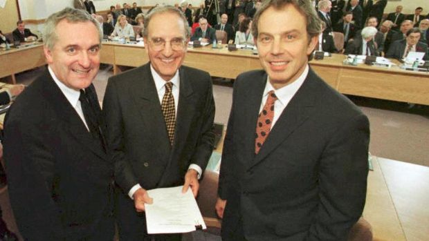 Bertie Ahern, Tony Blair and George Mitchell smiling on April 10th, 1998, after they signed a historic agreement for peace in Northern Ireland, ending a 30-year conflict. Photograph: Dan Chung