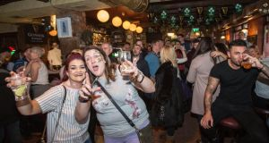 Grace Allen and Emma Ireland from Ballymena enjoying Good Friday drinks in The Auld Dubliner in Dublin. Photograph: Dave Meehan/The Irish Times
