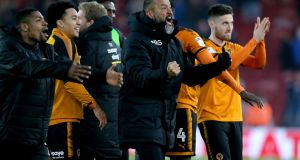 Wolverhampton Wanderers manager Nuno Espirito Santo (centre) celebrates after the final whistle during the Sky Bet Championship match against Middlesbrough  at Riverside Stadium. Photograph:  Richard Sellers/PA Wire
