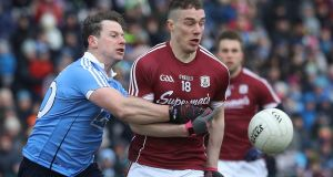 Dublin's Philly McMahon tussles for the ball with Galway's  Eamonn Brannigan at Salthill. The two are set to face each other again at Croke Park in the Division One final. Photograph: Lorraine O'Sullivan/Inpho