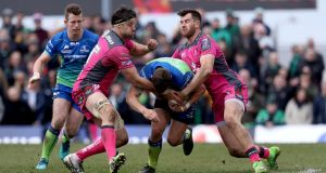 Connacht's Tom Farrell is stopped in his tracks by  Jeremy Thrush and Mark Atkinson of Gloucester. Photograph: Tommy Dickson/Inpho