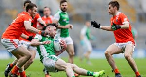 Fermanagh's Barry Mulrone is tackled by Brendan Donaghy of Armagh during the Allianz Football League Division Three final at  Croke Park. Photograph: Laszlo Geczo/Inpho