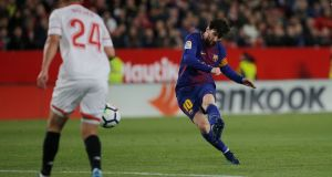 Lionel Messi fires home Barcelona's equaliser in the La Liga game against Sevilla at the  Ramon Sanchez Pizjuan. Photograph: Jon Nazca/Reuters