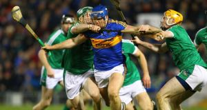 Tipperary's Jason Forde tries to break through the challenges of  Seán Finn and Richie English of Limerick during the Allianz Hurling League Division 1A semi-final at  Semple Stadium. Photograph: Ken Sutton/Inpho