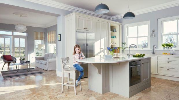Éabha in the open plan kitchen area with views into the living room. Photograph: Philip Lauterbach