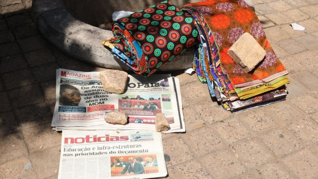 Newspapers for sale on a Maputo roadside, Mozambique. Photograph: Louise McLoughlin