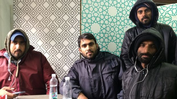 Asnar Emen (24), second from left, from Pakistan at the Refugee Aid Miksaliste centre in central Belgrade. He and his friends want to get to Italy. Photograph: Daniel McLaughlin