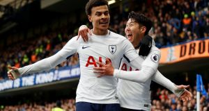 Tottenham's Dele Alli celebrates scoring their second goal with Son Heung-min during the Premier League game against Chelsea at Stamford Bridge. Photograph:  Peter Nicholls/Reuters