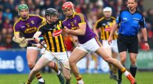Conor Delaney holds off Lee Chin during Kilkenny's win over Wexford. Photograph: Ken Sutton/Inpho
