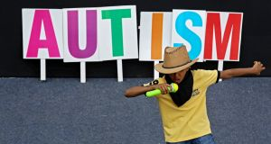 A child with autism performs during an event on the eve of 'World Autism Awareness Day' in Bangalore, India.