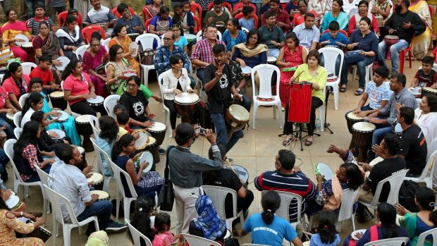 Children with autism and their relatives participate in a drum performance during an event on the eve of 'World Autism Awareness Day' organized by 'wiztara trust' NGO in Bangalore, India. Photograph: Jagadeesh HV/EPA
