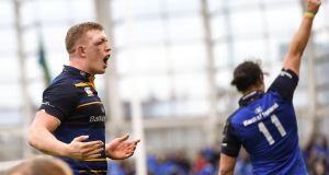 Dan Leavy and James Lowe  celebrate at the final whistle after Leinster's win over Saracens in the Champions Cup semi-finals at the Aviva Stadium. Photograph: Ramsey Cardy/Sportsfile via Getty Images