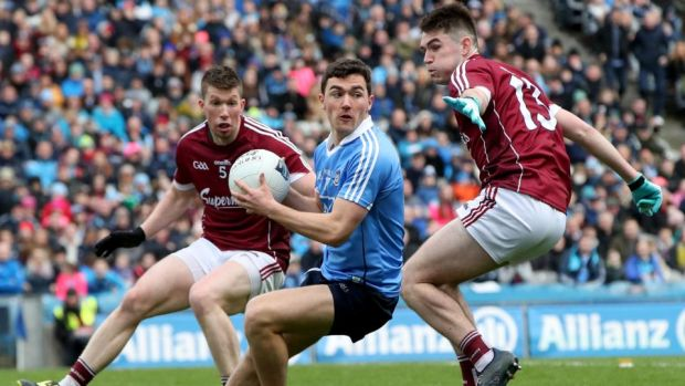 Dublin's Shane Carthy in action against Gareth Bradshaw and Barry McHugh of Galway during the Allianz Football League Division One Final at Croke Park. Photograph: Bryan Keane/Inpho