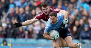 Galway's Damien Comer keeps a tight rein on Dublin's Philly McMahon during the Allianz Football League Division One  Final at  Croke Park. Photograph: Oisín Keniry/Inpho