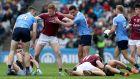 Dublin's Michael Darragh Macauley and Paul Conroy of Galway scuffle off the ball. Photograph: Bryan Keane/INPHO