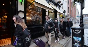 Tourists visiting Slattery's pub on Capel Street. Photograph: Alan Betson