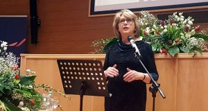 "Former president Mary McAleese addressing the ""Voices of Faith"" conference in Rome: to be heard, she had to speak outside the walls of the Vatican.    Photograph: Patsy McGarry"