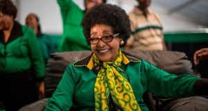 Winnie Madikizela-Mandela smiles as she is greeted by Women's League supporters gathered in Soweto to celebrate her 80th birthday in 2016. Photograph: AFP/Getty Images