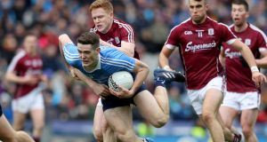Dublin's Brian Fenton is tackled by Galway's Ciarán Duggan during the Allianz Football League Division One final at Croke Park. Photograph: Bryan Keane/Inpho