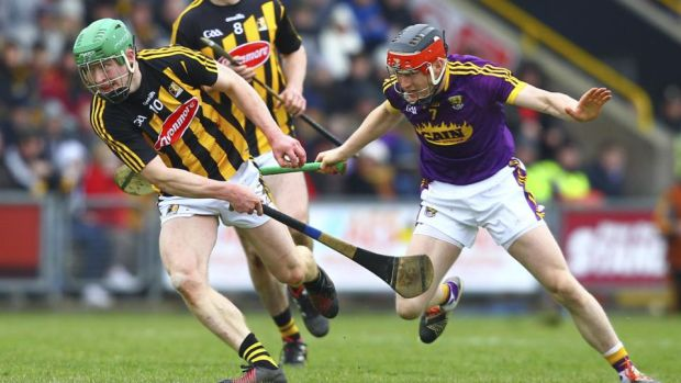 Kilkenny's Martin Keoghan holds off Wexford's Diarmuid O'Keeffe. Photograph: Ken Sutton/Inpho