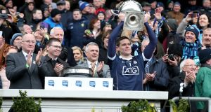Stephen Cluxton lifts the league title after Dublin's win over Galway. Photograph: Brian Keane/Inpho