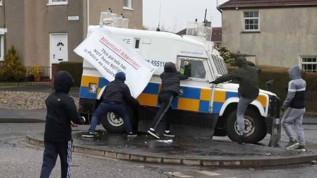 Youths attack PSNI vehicles as they try to prevent members of Derry 1916 Commemoration Committee from taking part in an unregistered parade in the the Creggan area of Derry, Northern Ireland. Photograph: Niall Carson/PA Wire