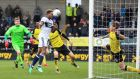 Middlesbrough's Britt Assombalonga heads home a late equaliser  during the Championship match against Burton Albion  at the Pirelli Stadium. Photograph:  Nigel French/PA Wire
