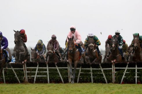 Andrew Lynch onboard Ah Littleluck (pink hat) comes home to win the Fairyhouse Steel Handicap Hurdle. Photograph: Bryan Keane/Inpho