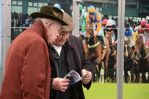 John Slattery from Limerick and Peter Donnelly from Rathoath look at the racecard. Photograph: Dara Mac Dónaill