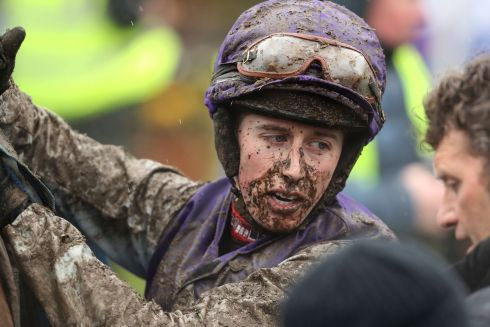 Jockey Bryan Cooper dismounts Quamino after the Farmhouse Foods Novice Handicap Hurdle. Photograph: Bryan Keane/Inpho