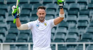 South Africa captain Faf du Plessis celebrates his 100 runs during day four of the Test match against Australia at Bidvest Wanderers Stadium. Photograph: Sydney Seshibedi/Gallo Images