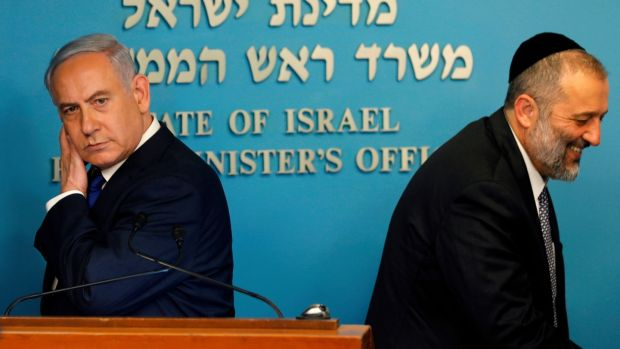 Israeli prime minister Binyamin Netanyahu and interior minister Arye Deri before a press conference in Jerusalem on Monday. Photograph: Menahem Kahana/AFP/Getty Images