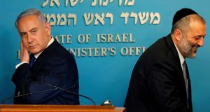 Israeli prime minister Binyamin Netanyahu and interior minister Arye Deri:   deal with UN refugee agency cancelled shortly after it was announced. Photograph: Menahem Kahana/AFP/Getty Images